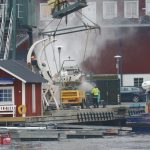 Arbete i en husbåtsmarina – men at work